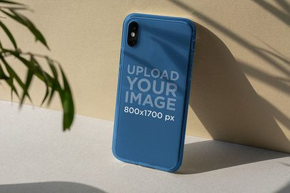 Mockup of a Clear Phone Case Placed Against a Wall 4599-el1