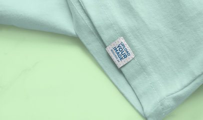 Sleeve Label Mockup Featuring a T-Shirt on a Flat Surface 4661-el1