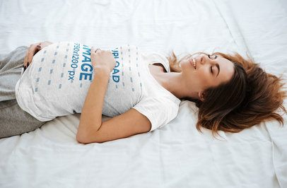Heathered Tee Mockup of a Happy Pregnant Woman Lying in a Bed 37242-r-el2