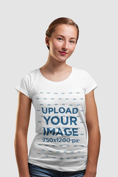 Mockup of a Young Woman Wearing a T-Shirt in a Studio 4445-el1