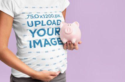 T-Shirt Mockup of a Pregnant Woman Holding a Piggy Bank 37021-r-el2