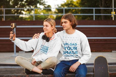Hoodie and Sweatshirt Mockup of Two Teens Taking a Selfie 37932-r-el2