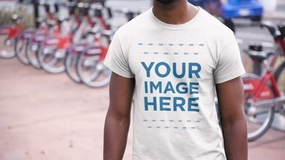 T-Shirt Video Mockup of a Young Black Man Going for a Bike Ride in the City a12354