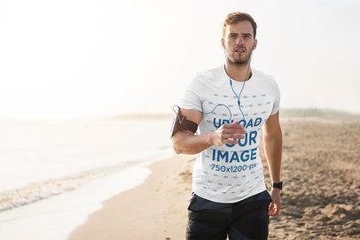 T-Shirt Mockup of a Man Jogging at the Beach 38234-r-el2