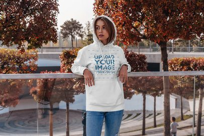 Pullover Hoodie Mockup of a Woman Standing in Front of Autumn Trees 4777-el1