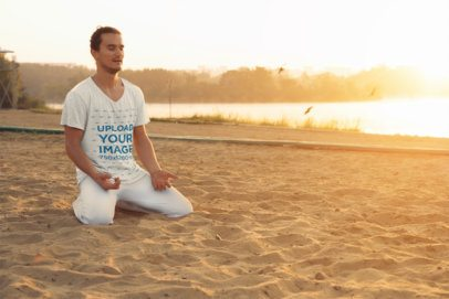 Mockup of a Man with a V-Neck Heathered Shirt Meditating on the Sand 38143-r-el2