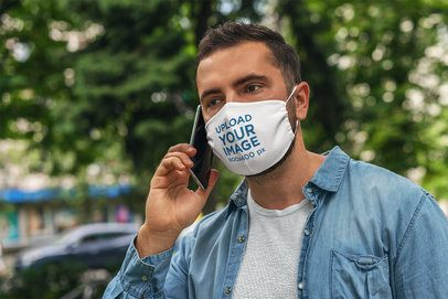 Face Mask Mockup Featuring a Man on His Phone 4679-el1