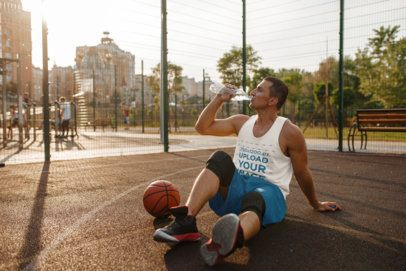 Tank Top Mockup of a Sporty Man Chilling at a Basketball Court 37971-r-el2