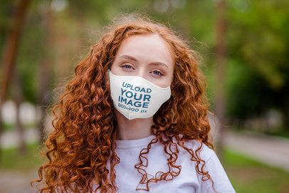 Mockup of a Woman With Curly Hair Wearing a Face Mask 4686-el1