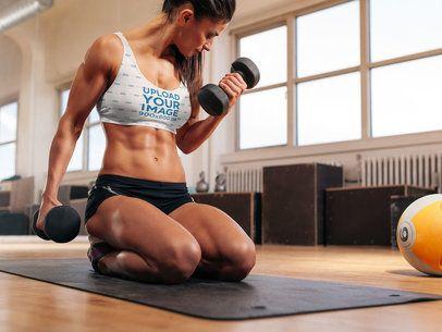 Sports Bra Mockup of a Woman Lifting Dumbbells 37118-r-el2