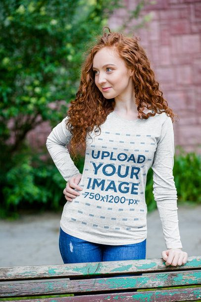 Heather Long Sleeve Tee Mockup Featuring a Curly-Haired Woman Posing by a Bench 4726-el1