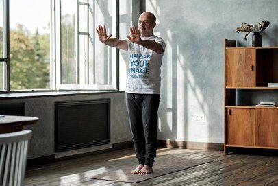 T-Shirt Mockup of a Man Practicing Tai Chi at Home 36965-r-el2