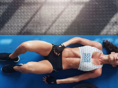 Sports Bra Mockup of a Woman Lying on the Floor 37174-r-el2