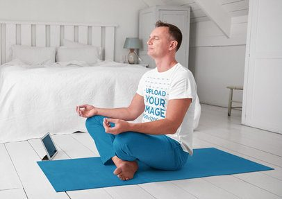 T-Shirt Mockup of a Middle-Aged Man Meditating at Home 37059-r-el2
