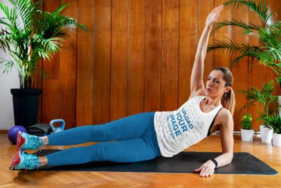 Tank Top Mockup of a Woman Doing Side Crunches at Home 37087-r-el2