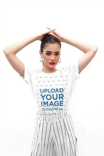 T-Shirt Mockup Featuring a Stylish Woman Posing With Her Hands on Her Head 4317-el1