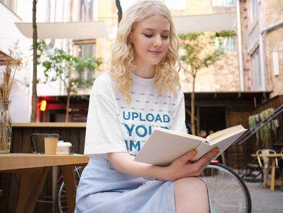T-Shirt Mockup of a Smiling Woman Reading a Book 38690-r-el2