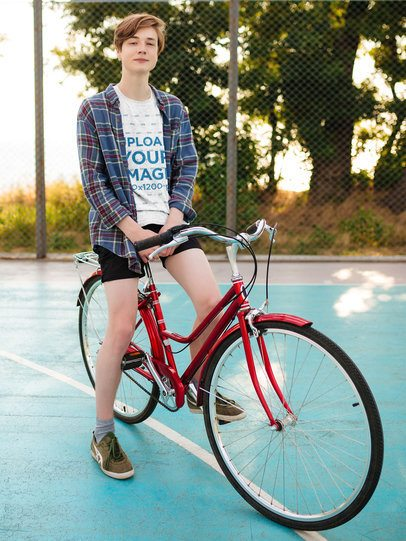 Mockup of a Young Man with a Heather Tee Riding a Bike 38698-r-el2
