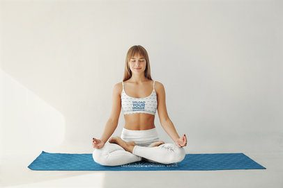 Mockup of a Woman Wearing a Sports Bra and Meditating 37331-r-el2