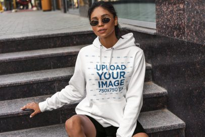 Hoodie Mockup of a Woman Sitting on a Granite Stairway 4857-el1