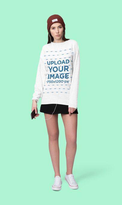 Mockup of a Young Woman Wearing a Sweatshirt in a Studio 4792-el1