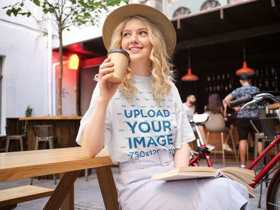Mockup of a Woman Wearing a Unisex T-Shirt at a Coffee Shop 38692-r-el2