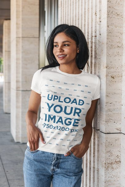 Mockup of a Woman Wearing a T-Shirt and Leaning Against a Granite Wall 4810-el1
