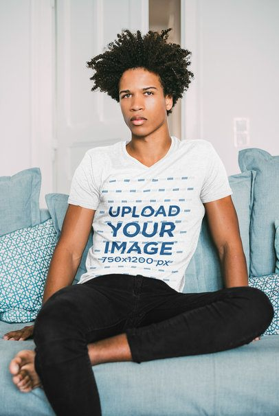 V-Neck Tee Mockup of a Serious Man Sitting on a Blue Couch 35193-r-el2
