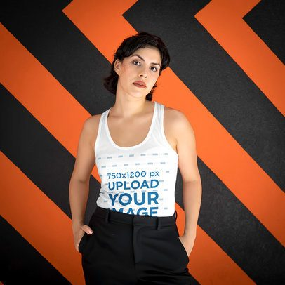 Mockup of a Serious Woman Wearing a Tank Top Against a Patterned Backdrop 4713-el1