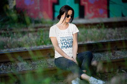 T-Shirt Mockup of a Woman Sitting on an Old Railway 4862-el1