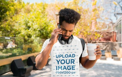 T-Shirt Mockup of a Serious Man Talking on the Phone on His Way to School 38637-r-el2