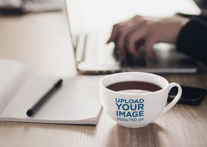 Mockup of a 24 oz Coffee Mug on a Wooden Desk 38298-r-el2