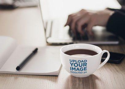 Mockup of a 24 oz Coffee Mug on a Wooden Desk 38298-r-el2