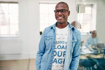 T-Shirt Mockup Featuring a Smiling Man with Glasses and Denim Garment 38962-r-el2