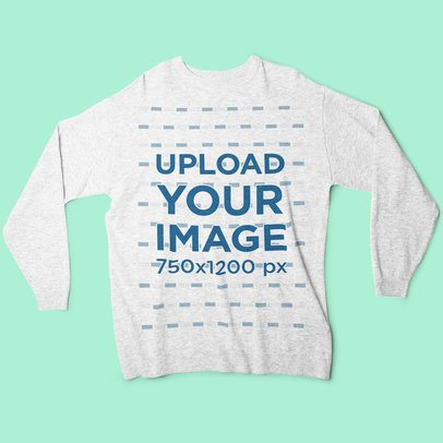 Mockup of a Heather Sweatshirt Lying on a Flat Surface 4796-el1