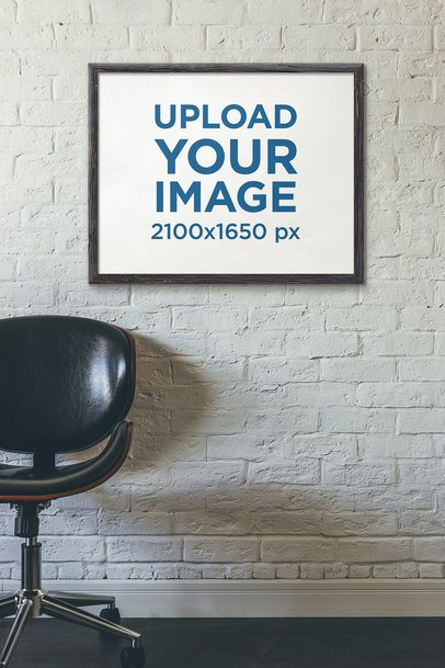 Mockup of a Framed Art Print Hanging Near a Leather Chair 4878-el1