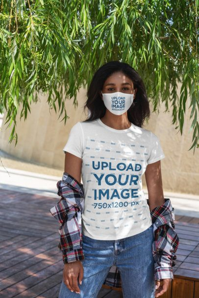 T-Shirt Mockup of a Woman Wearing a Face Mask Under a Tree 4819-el1