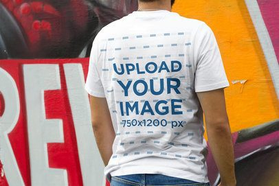 Back-View Mockup of a Man Wearing a Customizable T-Shirt by a Graffitied Wall 4873-el1