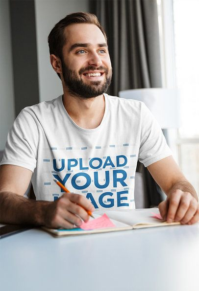 T-Shirt Mockup of a Smiling Man Taking Notes 38156-r-el2