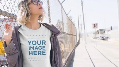 Trendy Short Haired Girl Walking Near a Fence Apparel Video 13462