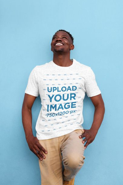 T-Shirt Mockup of a Man Leaning Against a Colored Wall 37763-r-el2