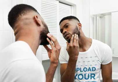 T-Shirt Mockup of a Man Checking His Beard in the Mirror 38815-r-el2