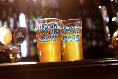 Mockup of Two Beer Glasses on a Bar Counter 36114-r-el2