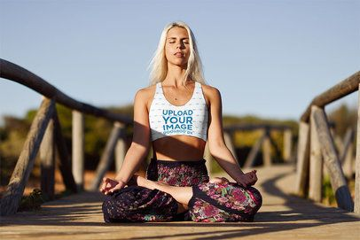 Sports Bra Mockup Featuring a Woman Meditating on a Pier 38380-r-el2