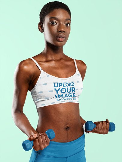 Sports Bra Mockup of a Serious Woman Posing With a Pair of Dumbbells at a Studio 38525-r-el2
