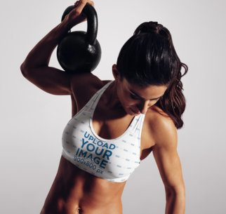 Sports Bra Mockup of a Fit Woman Lifting a Kettlebell 38329-r-el2