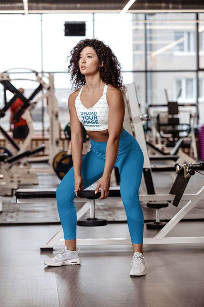 Sports Bra Mockup Featuring a Woman Training Legs with a Dumbbell 38626-r-el2