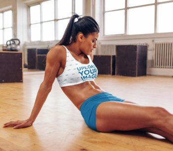 Sports Bra Mockup Featuring a Fit Woman Sitting on the Floor 38319-r-el2