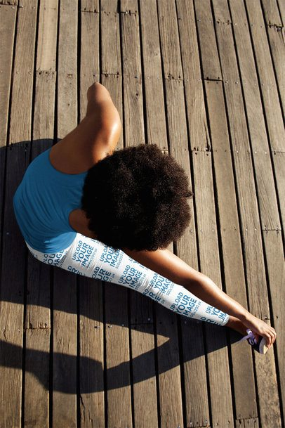 Sports Leggings Mockup of a Woman Stretching Her Leg on a Wooden Floor 38403-r-el2