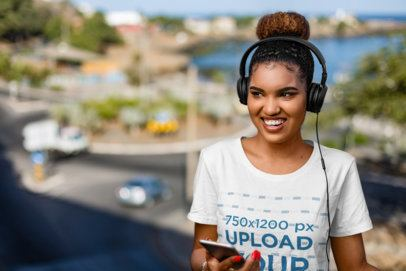T-Shirt Mockup of a Happy Woman Listening to Music with a Pair of Headphones 36397-r-el2